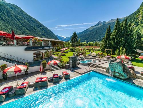 A view of the pool at Relais&Châteaux Spa-Hotel Jagdhof or nearby