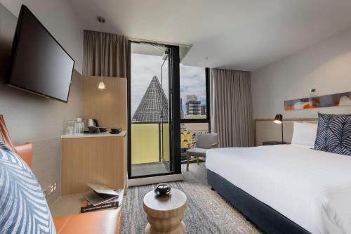 A bed or beds in a room at Brady Hotels Central Melbourne