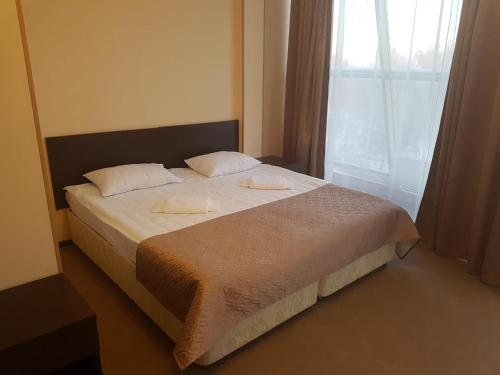 Кровать или кровати в номере Отель Кремлевский