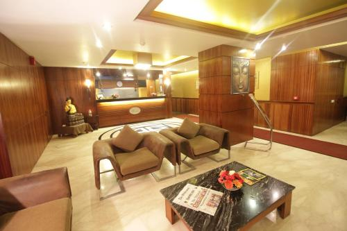 The lobby or reception area at Suhim Portico Hotel