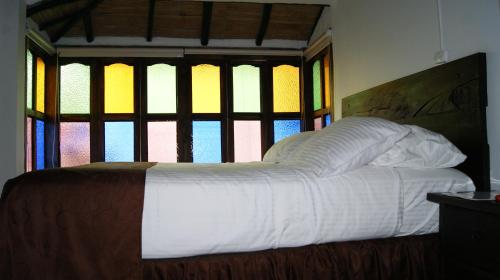 A bed or beds in a room at Samay Boutique Hotel