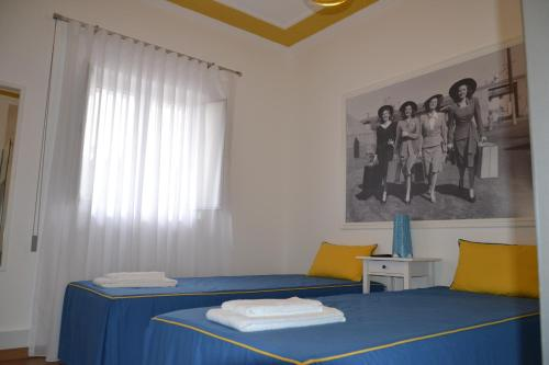 A bed or beds in a room at Casa do Ti Luís