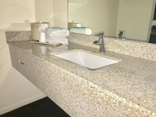 A bathroom at Budget Host Inn Florida City