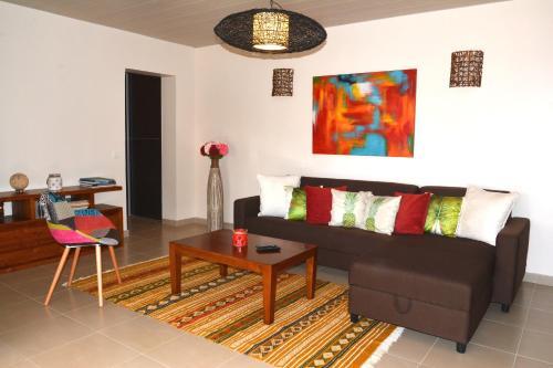 Uma área de estar em Appartement Villa Taina piscine