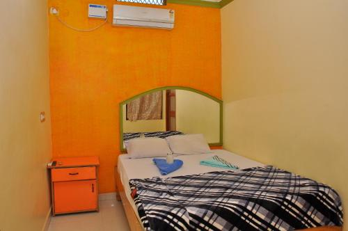 A bed or beds in a room at Thilak Home Stay