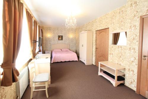 Кровать или кровати в номере Отель Альпийская Сказка