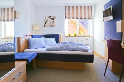 Ein Bett oder Betten in einem Zimmer der Unterkunft Pension Reiter-Moravec
