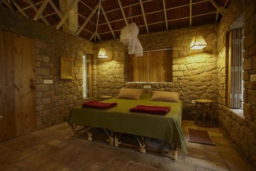 A bed or beds in a room at Indhrivanam