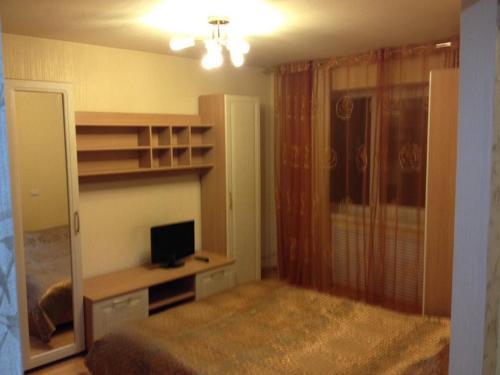 Телевизор и/или развлекательный центр в Center City Apartment