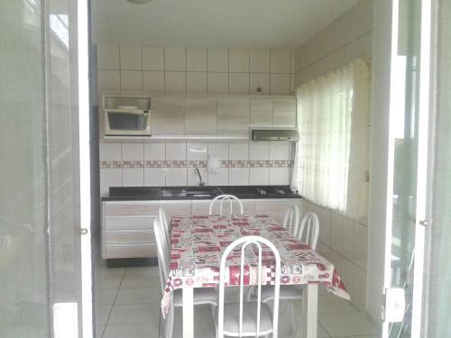 A cozinha ou cozinha compacta de Casa na Praia do Forte