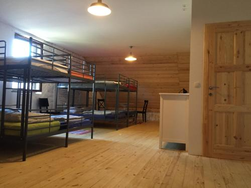A bunk bed or bunk beds in a room at Vila Mangart