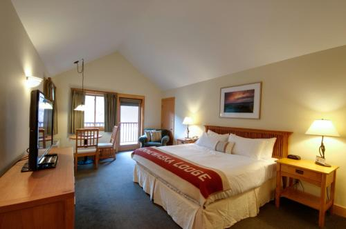 A bed or beds in a room at Minnewaska Lodge