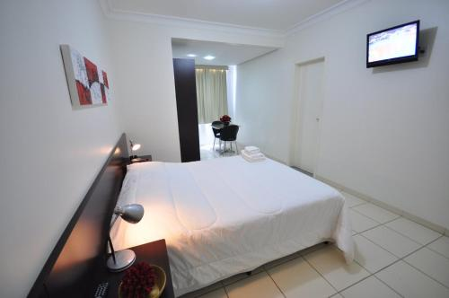 Cama ou camas em um quarto em Hotel FIT