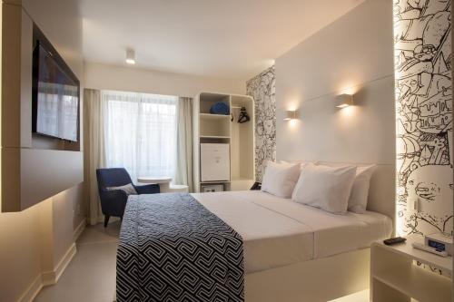 Cama ou camas em um quarto em ibis Styles Rio de Janeiro Botafogo