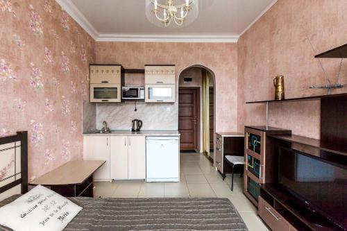 Кухня или мини-кухня в Апартаменты «Светлана-Центр»