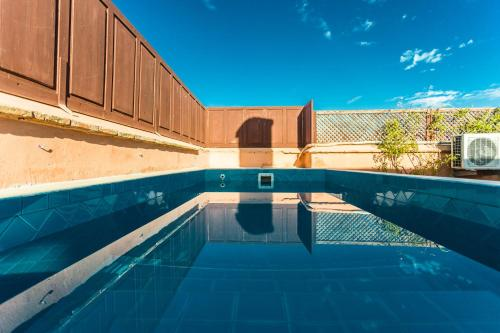 The swimming pool at or near Riad Nasreen