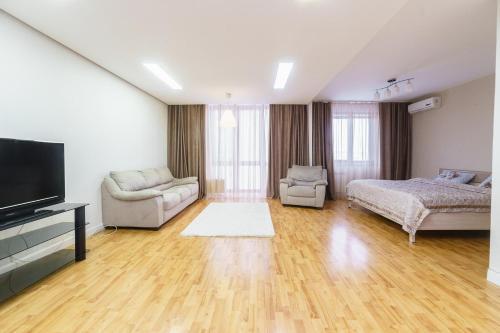 Телевизор и/или развлекательный центр в Apartment on pr-t Lenina 148