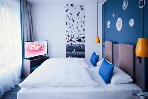 Un ou plusieurs lits dans un hébergement de l'établissement Vienna House Easy Berlin