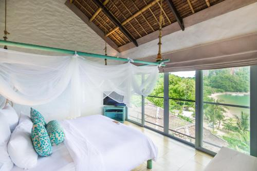 A bed or beds in a room at Paradise KohYao - SHA Plus