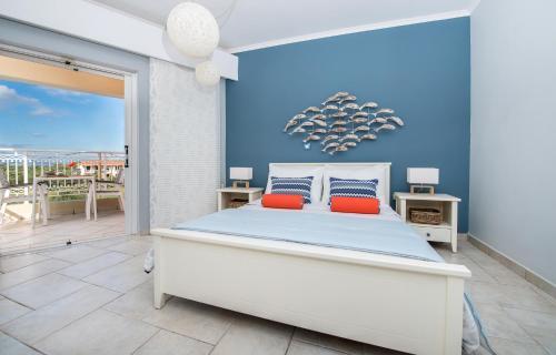 Ένα ή περισσότερα κρεβάτια σε δωμάτιο στο Arkadia Hotel