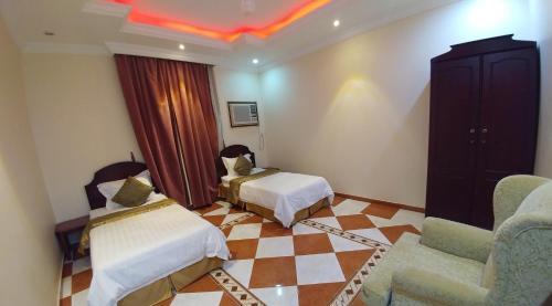 Cama ou camas em um quarto em Al Abha