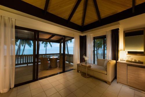 A seating area at DoubleTree by Hilton Fiji - Sonaisali Island