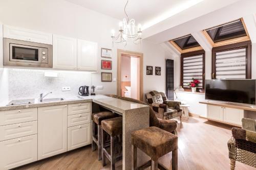 Una cocina o zona de cocina en Parkside Apartments Old Town