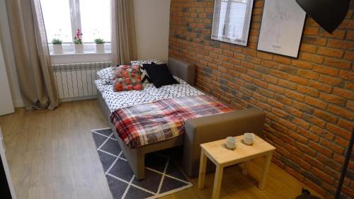 Łóżko lub łóżka w pokoju w obiekcie Family Comfort Apartament Old Town Gdańsk - studio & sofa, 1 bedroom, parking