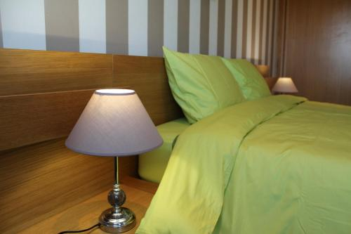 A bed or beds in a room at Portus Cale Apartment