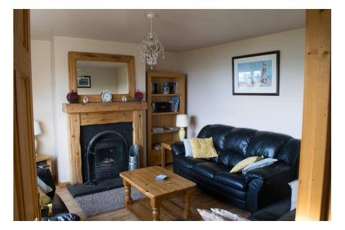 A seating area at Beachview Cottage Co. Antrim