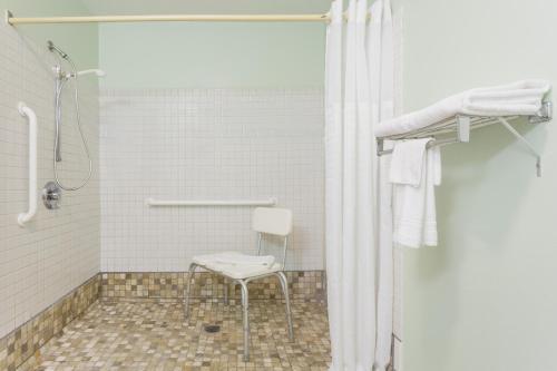 A bathroom at Super 8 by Wyndham Gallipolis Pt Pleasant Area