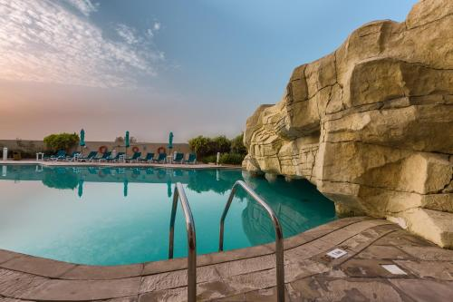 The swimming pool at or near Park Hotel Apartments