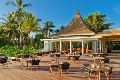 A restaurant or other place to eat at Kuramathi Maldives