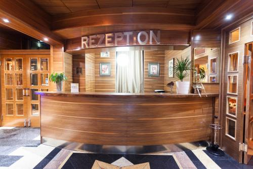 The lobby or reception area at Best Western Hotel Strasser