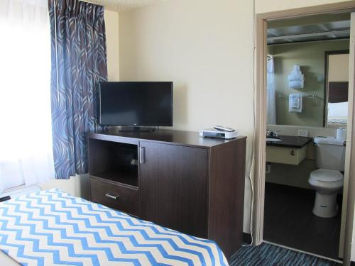 A television and/or entertainment center at Travelodge by Wyndham Aberdeen