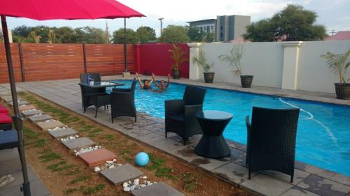 The swimming pool at or near Nicopolis Self-Catering Apartments