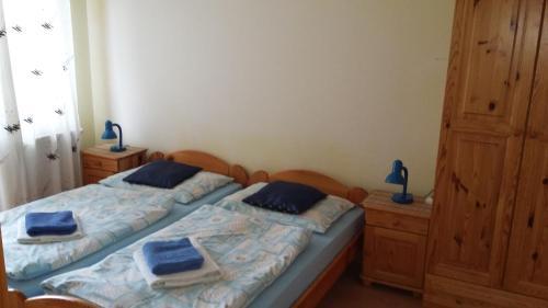 Łóżko lub łóżka w pokoju w obiekcie Vila Marko