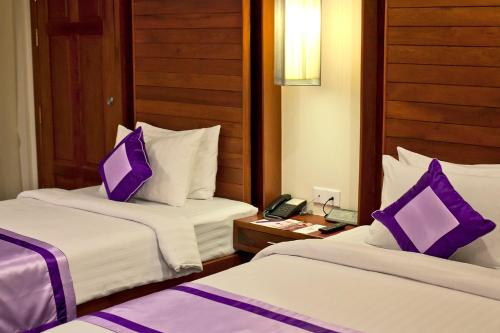 A bed or beds in a room at Angkor Miracle Resort & Spa