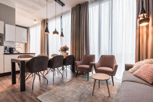 A seating area at Amsterdam North by YAYS
