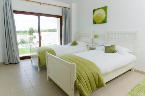 A bed or beds in a room at Lagoon Villa