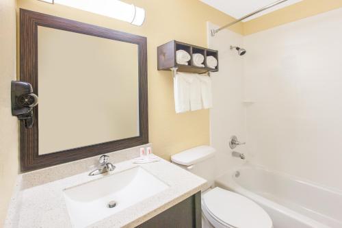 A bathroom at Days Inn by Wyndham Miami