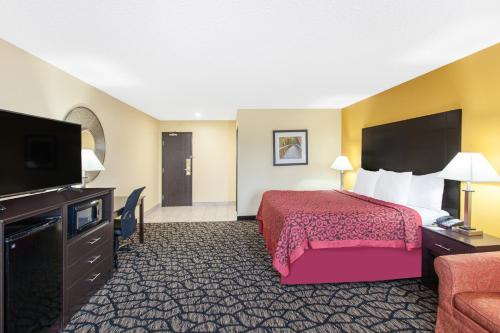 A television and/or entertainment center at Days Inn by Wyndham Miami