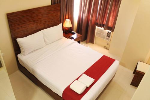 A bed or beds in a room at Sebastien Hotel