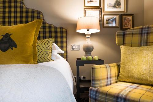 A bed or beds in a room at The Lygon Arms Hotel