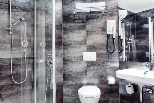 Ein Badezimmer in der Unterkunft Hotel Internazionale Bellinzona