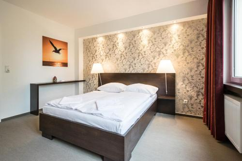 A bed or beds in a room at Fair Apartments