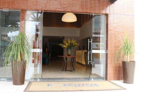 The facade or entrance of Executive Hotel