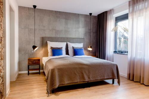 A bed or beds in a room at Gasthaus Stappen