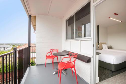 A balcony or terrace at Nightcap at Camp Hill Hotel