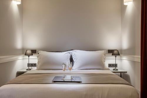 A bed or beds in a room at The Zillers Boutique Hotel